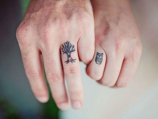 тату сова и дерево на пальцах рук