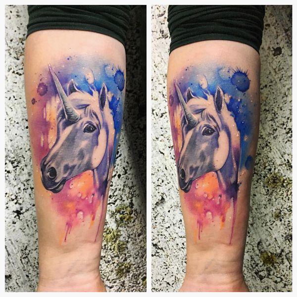 Акварельная татуировка лица единорога