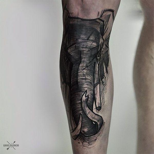 Татуировка голова слона чёрный эскиз на ноге