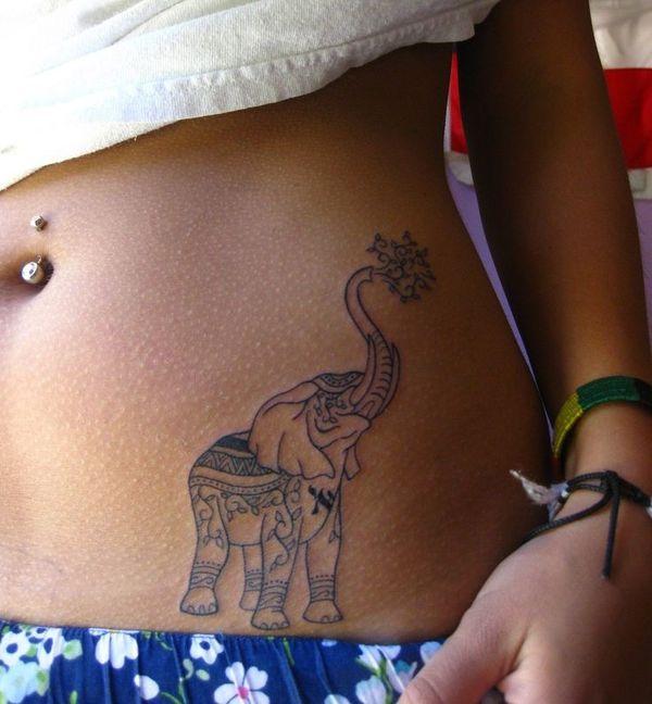 Полинезийское тату со слоном хоботом на животе